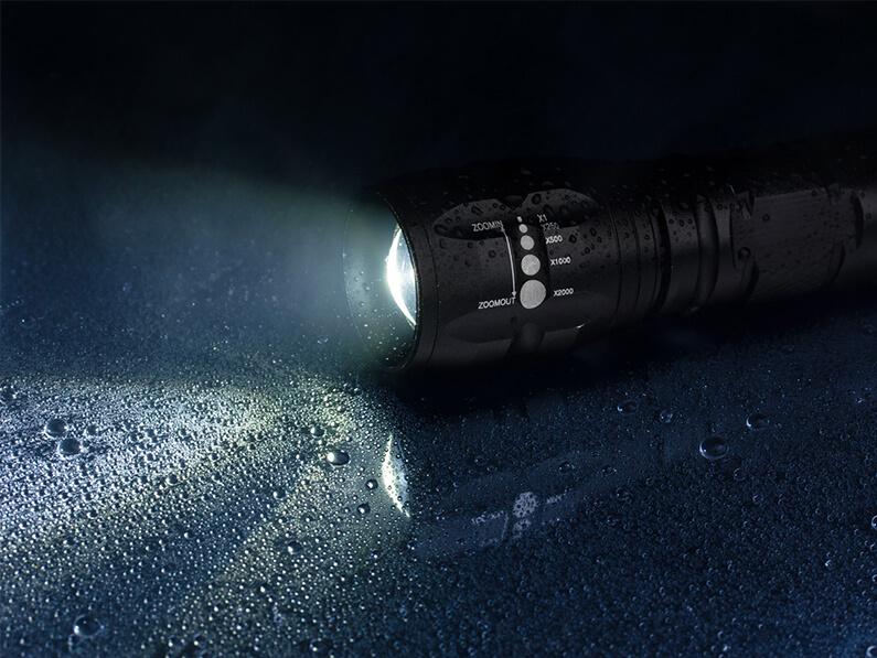 New flashlight illuminating the wet ground